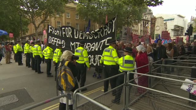 vídeos de stock, filmes e b-roll de whitehall protests england london whitehall ext protesters marching including paul mason with large banner 'fight for democracy / defend migrants /... - stop placa em inglês