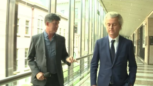 geert wilders interview netherlands amsterdam ext gv city centre canal with pleasure boat cyclists along city centre cycle path close shot of... - binnenhof stock videos and b-roll footage