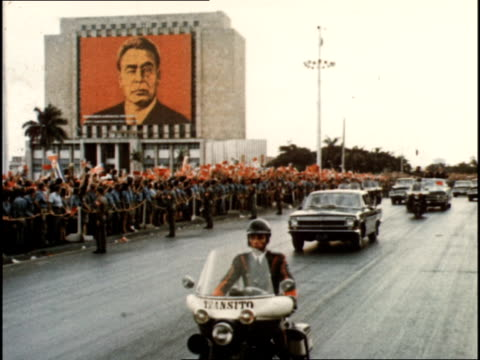 brezhnev and castro travel in motorcade along streets full of flag waving cubans - parade stock videos & royalty-free footage