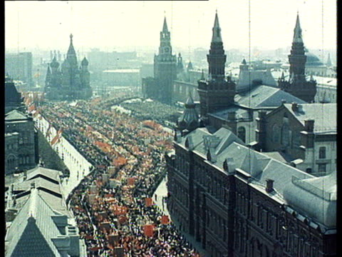 Brezhnev industrial propaganda CU big Soviet emblem aer Red Square WS May Day parade on Red Square in Moscow Brezhnev waving at the crowd from the...