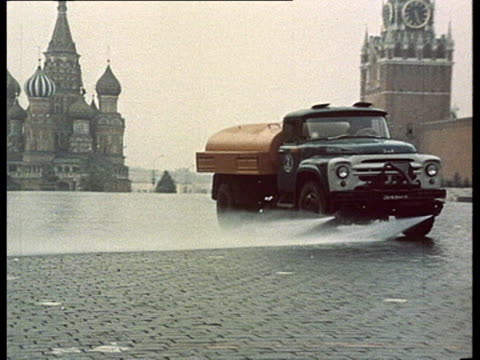 brezhnev industrial propaganda workers in factories architecture building sites working soviet people ws empty red square w/ truck throwing water to... - automobile industry stock videos & royalty-free footage