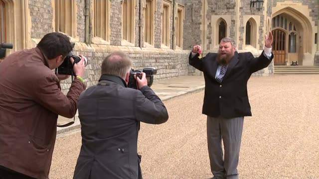 berkshire windsor windsor castle ext brian blessed posing for photos with obe medal - order of the british empire stock videos and b-roll footage