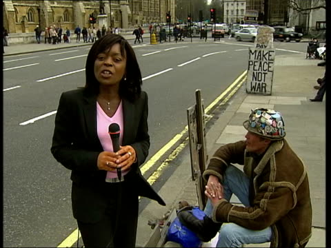 Brian Haw Iraq protest threatened ITN London Westminster EXT i/c Brian Haw interview SOT Posters i/c MS Big Ben clock at 2 o'clock Brian Haw standing...
