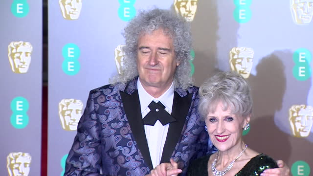 Brian May and Anita Dobson pose for photos on red carpet at BAFTA Film Awards at Royal Albert Hall