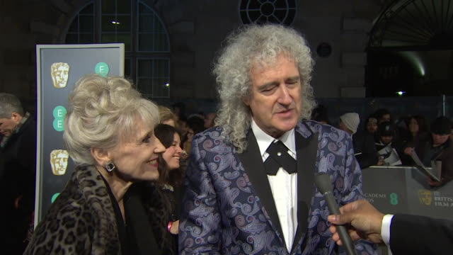 brian may interview on the bafta red carpet about the film bohemian rhapsody including mention of bryan singer - british academy film awards stock videos & royalty-free footage