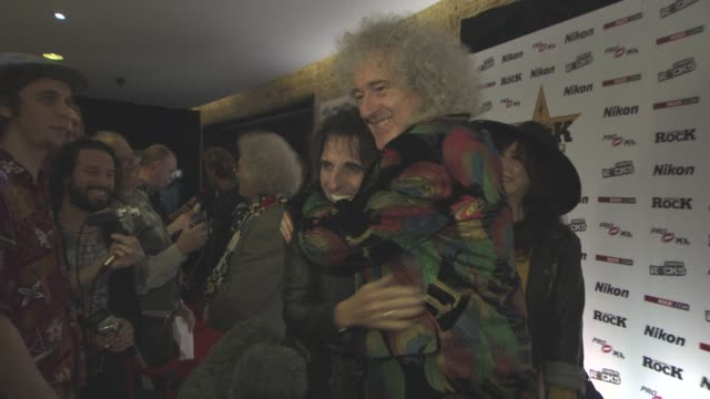 vídeos de stock e filmes b-roll de interview brian may on being at the awards queen being honored on adam lambert at classic rock and roll of honour at the roundhouse on november 11... - rocking