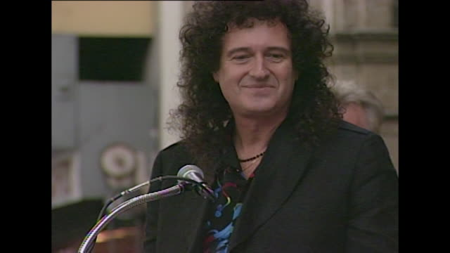 Brian May QUEEN guitarist Roger Taylor Drummer Queen Queen rock band Hollywood Walk of Fame ceremony