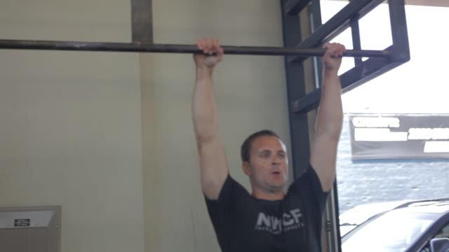 Brian performs kipping pull-ups.
