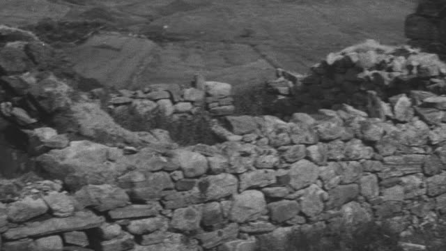 1944 montage brick abodes and thatched roofs of crofting community / achriesgill, scotland, united kingdom - achriesgill stock videos and b-roll footage