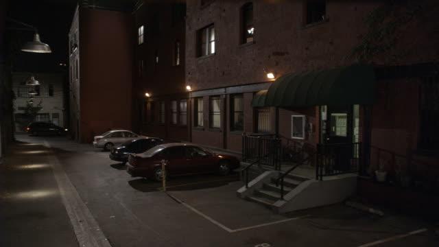 ws, pan, brick apartment building at night, brooklyn, new york city, new york, usa - pedestrian walkway stock videos & royalty-free footage