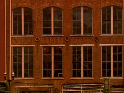 a brick building with multiple windows - brick stock videos & royalty-free footage