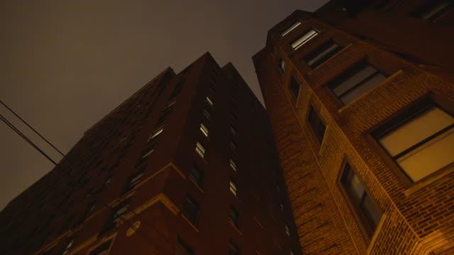 brick highrise night exterior - brick stock videos & royalty-free footage