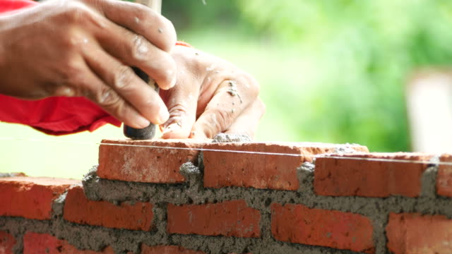 brick installation - wall building feature stock videos & royalty-free footage