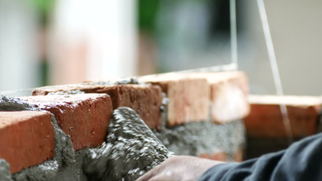 brick installation - construction worker stock videos and b-roll footage