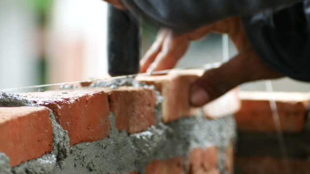 brick installation - construction industry stock videos & royalty-free footage