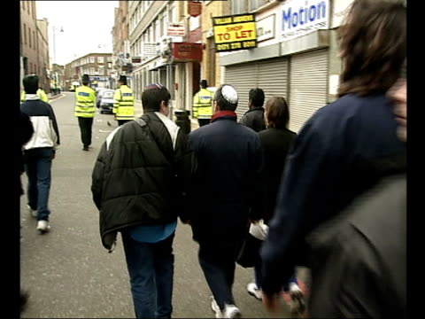 brick lane bomb; a)22.30: lauren taylor england: london: whitechapel: brick lane: ext gv local people along bv police away along road with local... - jack straw stock videos & royalty-free footage