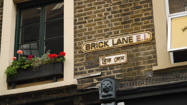 brick lane street sign in both english and bengali - multiculturalism stock videos & royalty-free footage