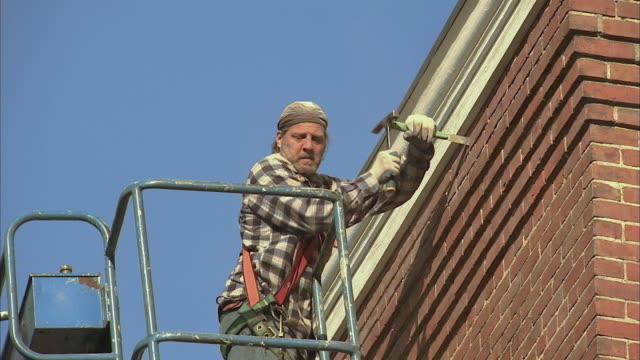 ms la brick layer in cherry picker fixing brick on side of building / rutland, vermont, usa - cherry picker stock videos & royalty-free footage