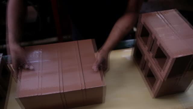 brick production and distribution at ladrillera helios in bogota, colombia on sunday, may 3, 2018. - adobe bildbanksvideor och videomaterial från bakom kulisserna