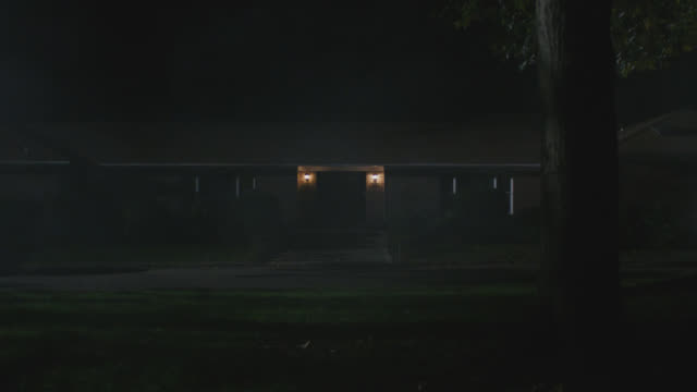 brick ranch house, night, porch light on - ranch house stock videos & royalty-free footage