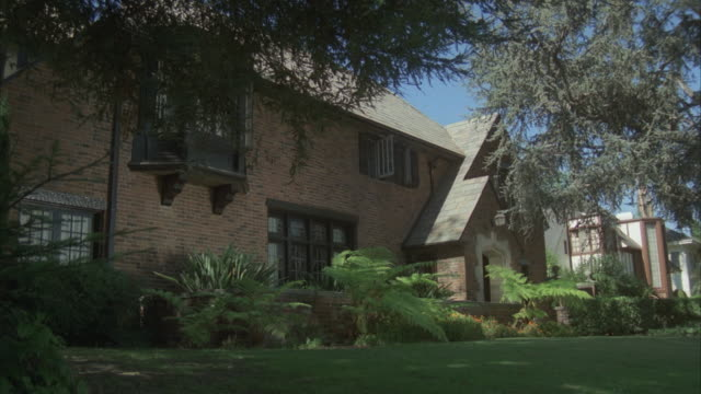 ms, brick, two story english style house - 1980 stock videos and b-roll footage
