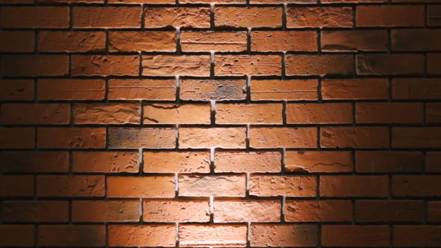 brick wall with spot light background shot on smart phone - vignette stock videos & royalty-free footage