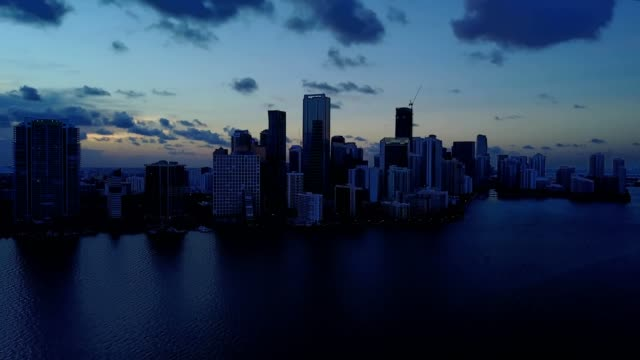 brickell miami florida skyline at sunset over biscayne bay - biscayne bay stock videos and b-roll footage