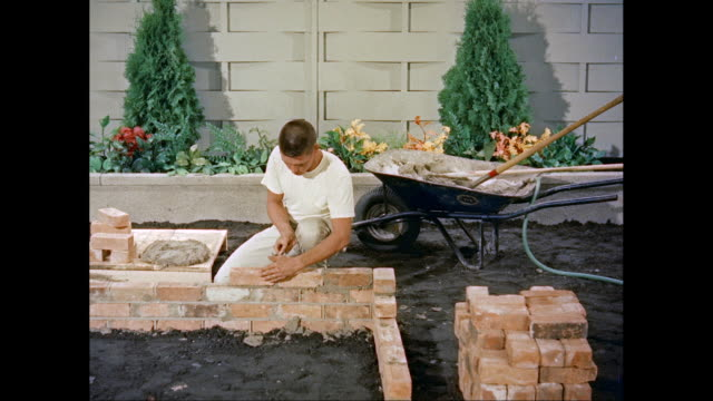 MS Bricklayer building brick wall / United States