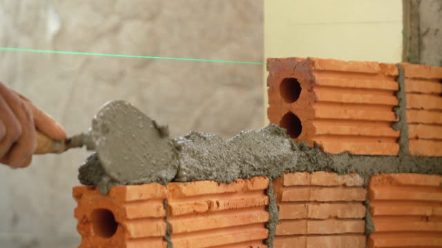 bricklayer construction brick wall - arranging stock videos and b-roll footage