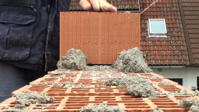 hd: bricklaying - audio available stock videos & royalty-free footage
