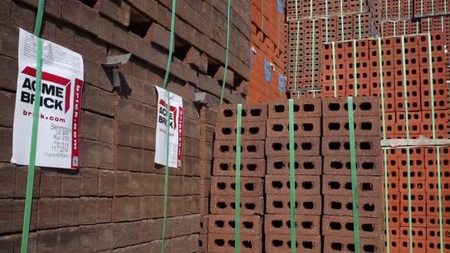 Bricks are manufactured at the Acme Brick Company plant in Leeds Alabama US Acme Brick signage stands outside their manufacturing Plant in Leeds...