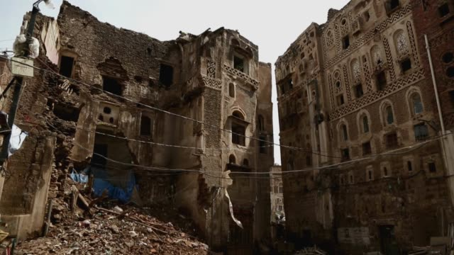 bricks fall from the buildings of the historic old quarter of sana'a still standing as recent rains have threatened the city's heritage sites through... - unesco world heritage site点の映像素材/bロール