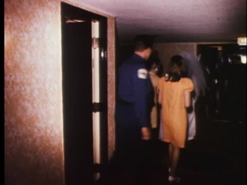 bridal attendants escort elvis presley's bride-to-be priscilla beaulieu to the chapel. - プリシラ プレスリー点の映像素材/bロール