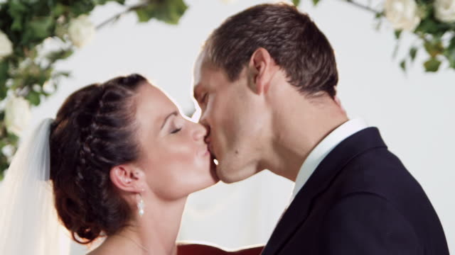 Bridal couple kissing for photo