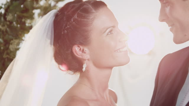 bridal couple kissing for photo - married stock videos & royalty-free footage
