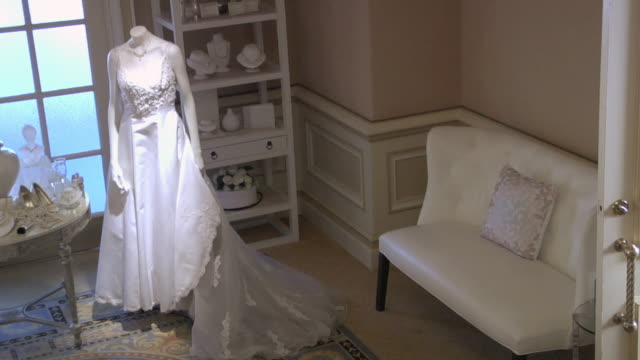 WS Bridal shop with wedding dress and reception accessories on display / United States