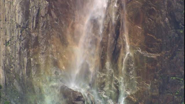 bridalveil falls tumbles down a sheer cliff in yosemite national park. - yosemite national park stock videos and b-roll footage