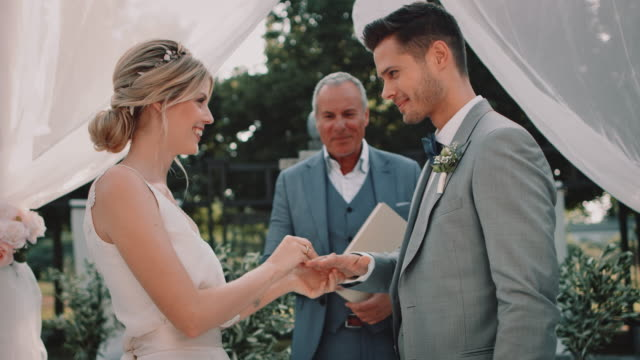 bride and bridegroom exchanging wedding rings - wedding ceremony stock videos & royalty-free footage