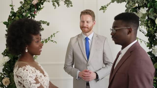 bride and bridegroom exchanging wedding vows - wedding vows stock videos & royalty-free footage