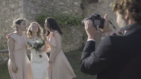 bride and bridesmaids having photos taken - photographer stock videos & royalty-free footage