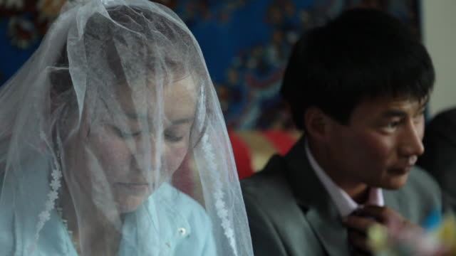 bride and groom at kazakh wedding party - kazakhstan stock videos and b-roll footage