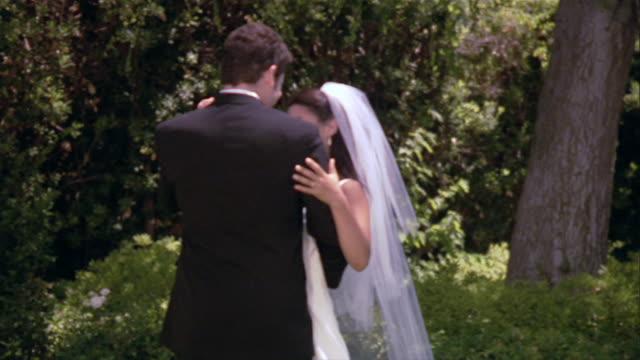 SLO MO MS Bride and groom dancing at outdoor wedding / Los Angeles, California, USA