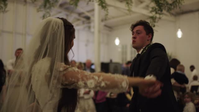 stockvideo's en b-roll-footage met bride and groom dancing at wedding reception / provo, utah, united states - bruidegom