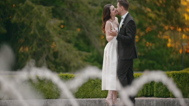 slo mo bride and groom dancing by the water fountain - fountain stock videos & royalty-free footage