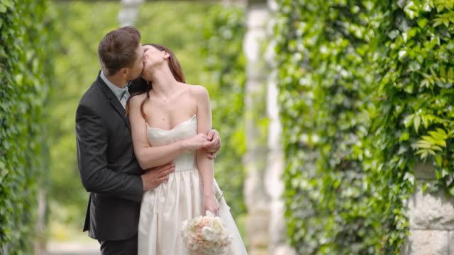 SLO MO Bride and groom dancing in passageway