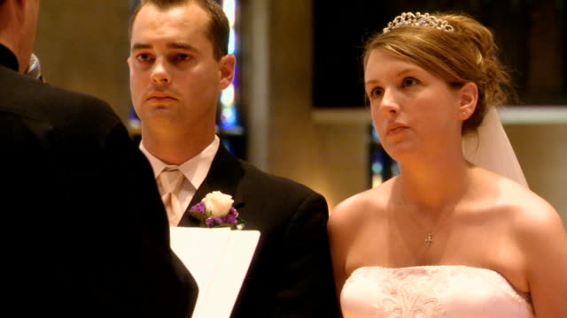 bride and groom during thier wedding ceremony - pastor stock videos & royalty-free footage