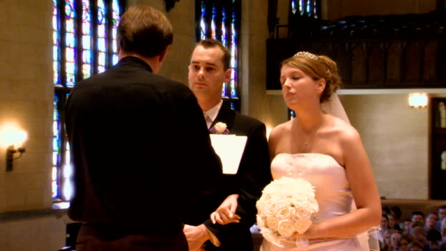 bride and groom during wedding ceremony - pastor stock videos & royalty-free footage