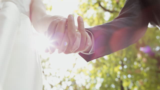 slo mo ts bride and groom holding hands - bridegroom stock videos and b-roll footage