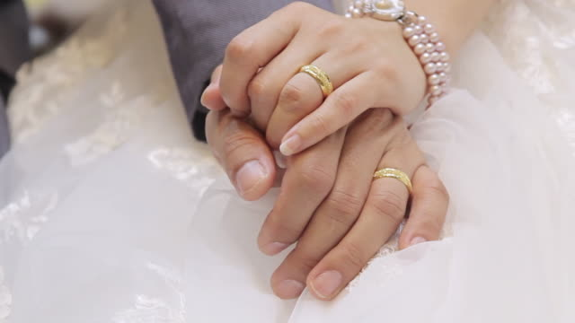 bride and groom holding hands with wedding rings - ring stock videos and b-roll footage