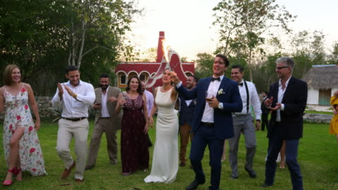 ms bride and groom holding sparkler together while celebrating with friends - 30 39 years stock videos & royalty-free footage